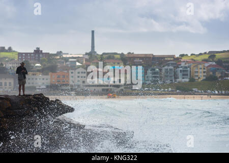 Sea spray from wave hitting rocks off the coastal walk between Bondi and Bronte beaches. Eastern suburbs, Sydney, - Stock Photo