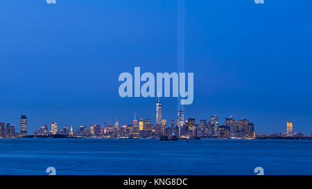 New York City skyline with skyscrapers and two beams of the Tribute in Light. Lower Manhattan, Financial District, - Stock Photo
