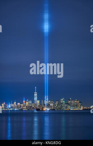New York City skyline with skyscrapers and the two beams of the Tribute in Light. Lower Manhattan, Financial District, - Stock Photo