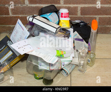 Assorted recyclable household waste collected in a pensioners home in Bangor County Down in Northern Ireland over - Stock Photo