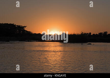 sunset on the okavango river in namibia - Stock Photo