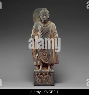 Standing Buddha. Date: ca. 3rd-4th century; Culture: Pakistan (ancient region of Gandhara); Medium: Schist; Dimensions: - Stock Photo