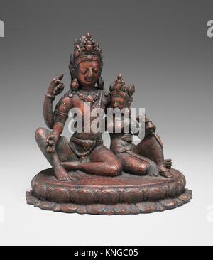 Shiva Seated with Uma (Umamaheshvara). Date: 11th century; Culture: Nepal (Kathmandu Valley); Medium: Copper alloy; - Stock Photo