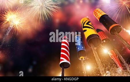 Bottom view of fireworks rockets launching into the sky, free space for text. Concept of celebration and New Years - Stock Photo