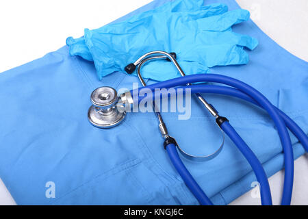 Medical stethoscope, Gloves, RX prescription on blue doctor uniform closeup. Medical tools and instruments shop, - Stock Photo