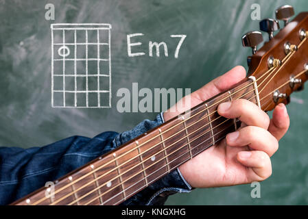 Man playing A minor chord on acoustic guitar Stock Photo: 25838780 ...