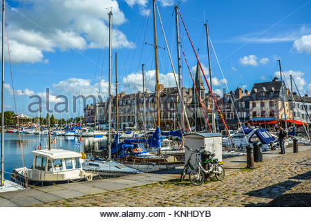 Sailboats in the picturesque old pier and harbor on the Normandy Coast at Honfleur France on a sunny, day - Stock Photo