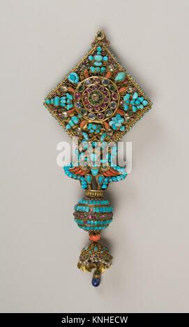 Ear Ornament for a Deity. Date: 17th-19th century; Culture: Nepal; Medium: Mercury, gilt silver, rubies, emeralds, - Stock Photo