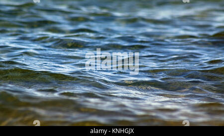 Calm blue waters with soft rippling waves on surface - Stock Photo