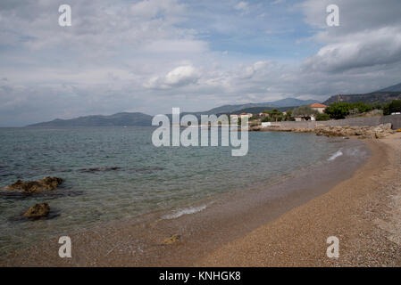 Mediterranean sea lap the beach at Stoupa in South west Greece - Stock Photo