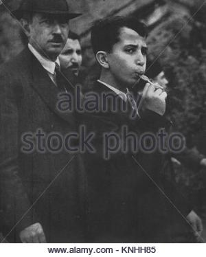 Faisal II (1935 - 1958) the last King of Iraq. Seen here at the age of 11 sucking a lollipop on a visit to Paris - Stock Photo