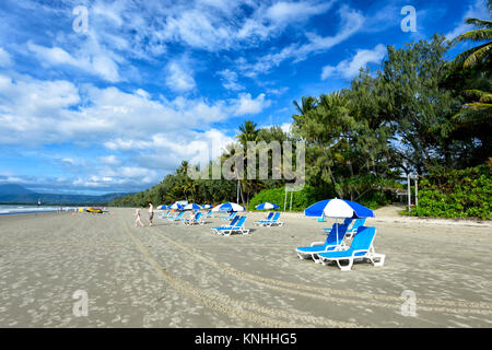 Blue and white sun loungers with parasols on Four Mile Beach, Port Douglas, Far North Queensland, FNQ, QLD, Australia - Stock Photo