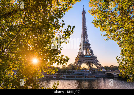 Sunrise at the Eiffel tower during autumn, Paris - Stock Photo