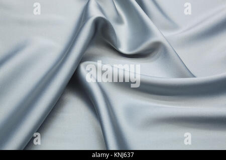 Wavy textile abstract background close up - Stock Photo