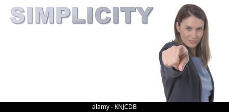 Business Woman pointing the text SIMPLICITY CONCEPT Business Concept. - Stock Photo