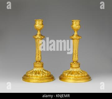 Pair of candlesticks. Date: ca. 1770-75; Culture: French; Medium: Gilt bronze; Dimensions: Overall (confirmed): - Stock Photo