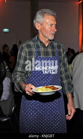 Munich, Germany. 11th Dec, 2017. Former national soccer player Paul Breitner supporting the Munchner Tafel e.V. - Stock Photo