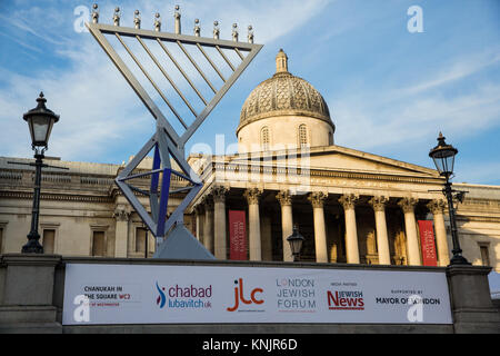London, UK. 12th Dec, 2017. A giant Menorah has appeared in front of the National Gallery on the north side of Trafalgar - Stock Photo