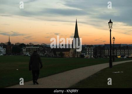 London, UK. 12th Dec, 2017. UK Weather. Winter sunset over All Saints' Church on Blackheath Common. : Credit: claire - Stock Photo