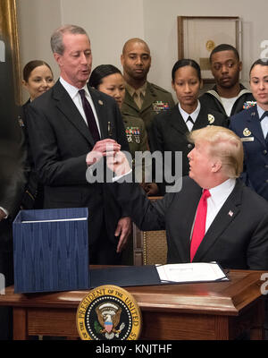 United States President Donald J. Trump, right, hands the signing pen to US Representative Mac Thornberry (Republican - Stock Photo