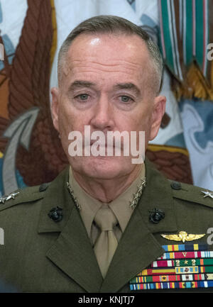 United States Marine Corps General Joseph F. Dunford Jr., Chairman, Joint Chiefs of Staff, looks on as US President - Stock Photo