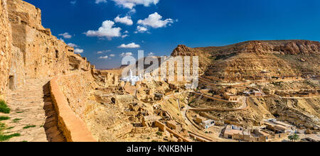 Panorama of Chenini, a fortified Berber village in South Tunisia - Stock Photo