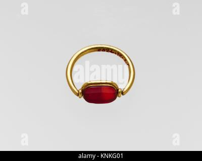 Gold ring with carnelian ring stone. Period: Classical; Date: 5th century B.C; Culture: Greek; Medium: Gold, sard; - Stock Photo