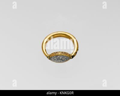 Gold ring with plasma ring stone. Period: Classical; Date: 5th century B.C; Culture: Greek; Medium: Gold, plasma; - Stock Photo