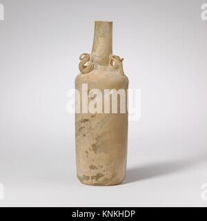 Glass bottle with dolphin handles. Period: Late Imperial; Date: 3rd-early 4th century A.D; Culture: Roman, Rhenish; - Stock Photo
