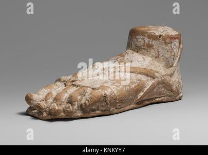 Terracotta left foot and ankle with sandal. Period: Late Classical; Date: 2nd half of the 4th century B.C; Culture: - Stock Photo