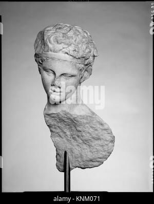 Head and part of the back of a marble statue. Copy of work attributed to Praxiteles; Period: Imperial; Date: 1st - Stock Photo