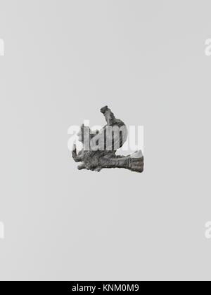 Statuette of a sphinx, 5. Culture: Greek, Laconian; Medium: Lead; Dimensions: Height: 13/16 in. (2.1 cm); Classification: - Stock Photo