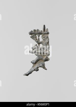 Ornaments, 14. Culture: Greek, Laconian; Medium: Lead; Dimensions: Height: 1 1/2 in. (3.8 cm); Classification: Miscellaneous - Stock Photo