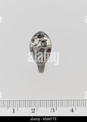 Silver ring. Period: Classical; Date: ca. late 5th or early 4th century B.C; Culture: Greek; Medium: Silver; Dimensions: - Stock Photo