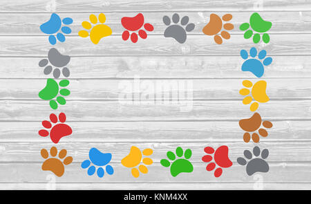Colorful paw prints animal frame on wooden background with copy space for text. - Stock Photo