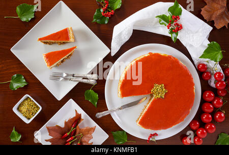 Savory cheesecake for Christmas prepared with cheese, zucchini, pistachios and tomato sauce. - Stock Photo