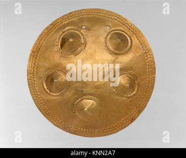 Pectoral Disk (Patena). Date: 11th-16th century; Geography: Panama; Culture: Veraguas (?); Medium: Gold; Dimensions: - Stock Photo