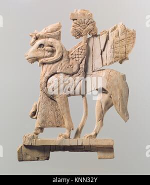 Openwork furniture plaque with ram-headed sphinx. Period: Neo-Assyrian; Date: ca. 9th-8th century B.C; Geography: - Stock Photo