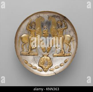 Plate with youths and winged horses. Period: Sasanian; Date: ca. 5th-6th century A.D; Geography: Iran; Culture: - Stock Photo