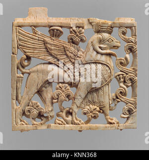 Openwork furniture plaque with a striding, ram-headed sphinx. Period: Neo-Assyrian; Date: ca. 9th-8th century B.C; - Stock Photo