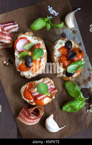 Bruschetta with bacon and tomato - Stock Photo