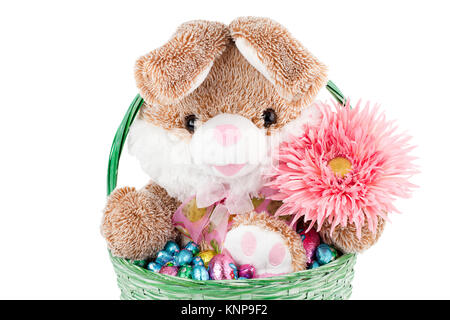 bunny and chocolates inside a basket - Stock Photo