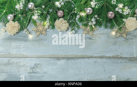Christmas border with trees, balls, stars and other ornaments, isolated on white. Studio shot - Stock Photo