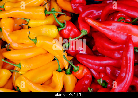 colourful yellow and red sweet peppers on market stall - Stock Photo