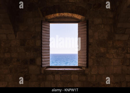 Old Vintage Window Open Shutters Looking Out at Ocean Castle Fortress Interior Perspective - Stock Photo