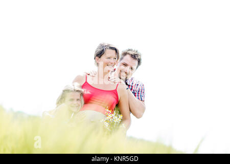 Schwangere Frau mit Mann und Tochter - pregnant woman with family - Stock Photo