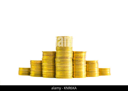 Savings, increasing columns of gold coins, piles of gold coins arranged as a graph isolated on white background, - Stock Photo