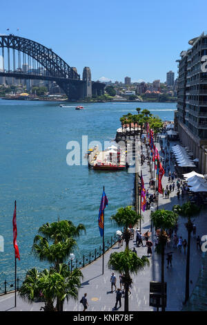 Elevated view of east side of Circular Quay, with Sydney Harbour Bridge in background - Sydney, New South Wales, - Stock Photo