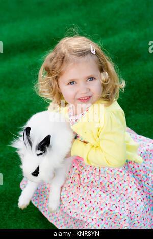 Kleines Maedchen mit Hase, Ostern - little girl with easter rabbit - Stock Photo