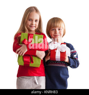 Portrait of two happy children with Christmas gift boxes isolated on white background - Stock Photo